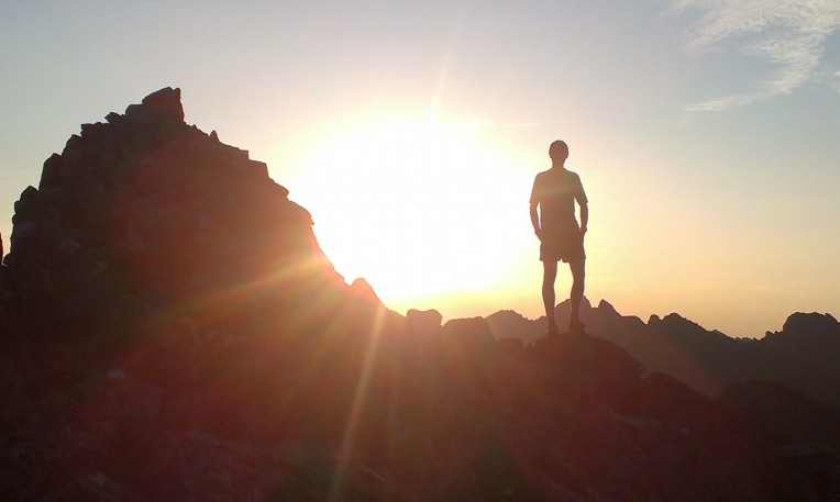 Finlay Wild silhouetted on the Cuillin ridge (1).jpg